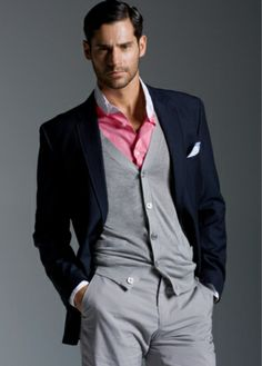 Lovely 3 piece suit, the vibrant pink shirt can easily turn this into a casual look when the tie is removed. theperfectgentleman.tv