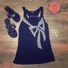 Forever 21 Black  Bow Tank Size Medium Adorable black tank from Forever 21 - size medium - with a white print bow on the front and and tie on the back of tank to also create a bow - super adorable - never worn - great condition Forever 21 Tops Tank Tops