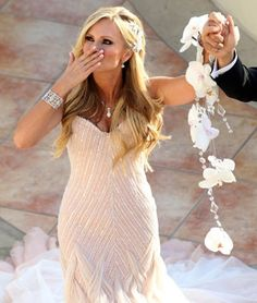 LOVE THE HANGING BOUQUET!!   Tamra Barney Wedding Photos - wedding season hair @Maggie Moore Cason