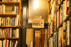 """bookstore in Amsterdam: """"Upstairs Thousands of Paperbacks""""  i want to visit!!"""