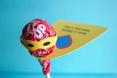 Super Hero suckers - Make the tag something about the birthday. Would be great as a party favor.