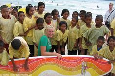 """Bethany Hamilton visited with children after the Tsunami in Thailand; to encourage them to not be afraid to go into the ocean again. She was 13yrs old when a 14 foot shark attacked her while surfing and severed her Left arm at the shoulder. """"Do not let your adorning be external—the braiding of hair and the putting on of gold jewelry, or the clothing you wear—but let your adorning be the hidden person of the heart with the imperishable beauty of a gentle and quiet spirit, which in God's sight…"""