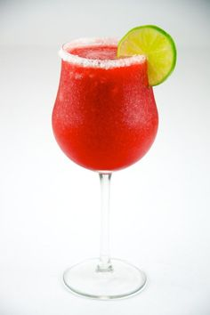 Strawberry Daiquiri with lime in a hurricane glass on a salted rim