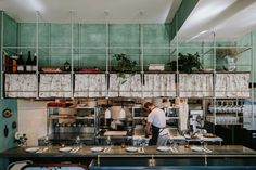 "The chefs' counter has above-bar metal and wood storage shelves. The counter is ""a light blue granite with an almost watercolor quality,"" Stanghetta says."