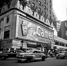 Times Square Camel sign, Hotel Clardige, 44th Street and Broadway. 1948. The sign, designed by Douglas Leigh, blew a five foot smoke ring every five seconds. It was on the side of the hotel from 1941-1966.