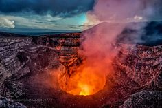 THE GATES OF HELL - Sunset at the active crater of The Masaya Volcano in Nicaragua by @robdesphoto  https://500px.com/photo/220419773/the-gates-of-hell-by-roberto-destarac?utm_campaign=crowdfire&utm_content=crowdfire&utm_medium=social&utm_source=pinterest #travel #tt #volcano #fire #lava #smoke #landscape #robdesphoto #Nicaragua #crater #nature #NatGeo #tbex #wanderlust #landscapephotography #naturelovers