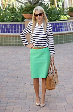 Black and white striped button up blouse beige leather belt, green knee length skirt, neutral tote, beige tote