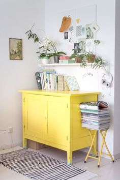 Update any piece of furniture with a few coats of yellow eggshell. This cupboard does all the talking here!
