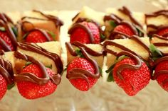 Strawberry and poundcake skewers drizzled with chocolate. I would remove the stems and hulls beforehand, so that guests don't have to worry about it.