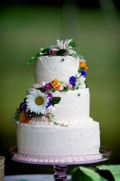 Beautiful way to accent a wedding cake:  natural look of wildflowers    Photo:  David Wittig Photography
