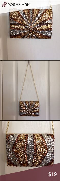 """La Regale Silver/gold/bronze sequin and beaded bag La Regale Silver/gold/bronze sequin and beaded bag. It can be worn as a shoulder bag, or you can take the chain in and use it as a clutch. It measures 7 3/4"""" across, 5 1/2"""" high and 2"""" wide. NWOT - The color of this is just beautiful and very versatile. La Regale Bags"""