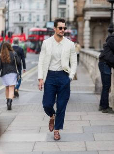 David Gandy wearing a creme jacket navy pants polo shirt during the London Fashion Week Men's June 2017 collections on June 12 2017 in London England