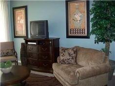 Floor Plan & Sq: Footage:- (C) - 1131nsf TV(3), DVD(3), VCR(2) Flooring: Carpet/Tile L/R: Tan sofa, oversized chair w/ brown/blue accents. D/R: Glasstop dark wicker/woven wood table. Seats 4 plus bar ...