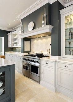 I like the mantel above the stove. Sleek Painted Kitchen – Tom Howley Me too! Also the contrasting greys are great! Kitchen Corner, Kitchen Mantle, Kitchen Dresser, Kitchen Remodel, Kitchen Design, Kitchen Diner, Kitchen Inspirations, New Kitchen, Kitchen Interior