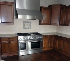 Backsplash of Travertine subway tile with a medallion accent.  Tile and install provided by Floor Value.