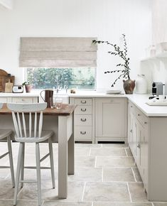 Suffolk - a modest chair from the 1700s spied on a family holiday in East Anglia inspired this entire kitchen. It nods, quietly, to Shaker-style design.