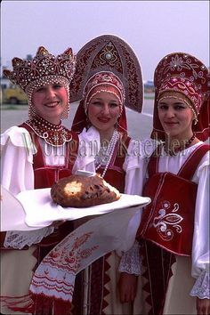 Women in traditional clothing in Sakhalin, Russia; welcome visitors at the airport, offering bread and salt~
