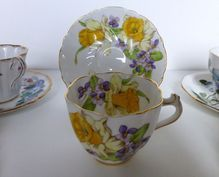 Stanley Bone China Daffodils footed teacup and saucer artist signed c 1952