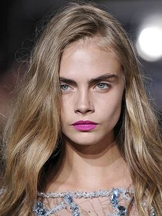 Cara Delevingne on the runway for the Giles spring 2013 runway show in London with beachy waves, bold brows and hot pink lipstick | allure.com
