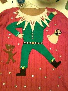 Elf Sweater: If you are attending an ugly Christmas sweater party this year, we have got you covered! Here are 25 Ugly Christmas Sweater Ideas for you to use as inspiration. Ugly Christmas Sweater Images, Ugly Christmas Tree, Tacky Christmas Party, Ugly Xmas Sweater, Christmas Sweaters, Diy Christmas, Christmas Costumes, Christmas Clothing, Elegant Christmas