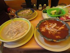 Mexican Food (pozole verde, rojo y blanco) Pork and white corn soup with avocado, onion, lime, and fried pork skin) Queretaro, Mexico September, 2014 ESLVentures.com