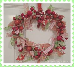 I cut strips of fabric and tied them with a simple knot onto the $2.50 Target wreath to give it a fuller look.