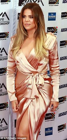 Khloe Kardashian stopped traffic in a pink silk wrap dress at the MTV Africa Awards, where she was supporting boyfriend French Montana http://dailym.ai/1igK6rU