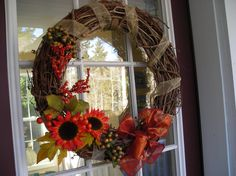 pretty wreath...bought some of the items used on it today. rustic burlap or pretty ribbon? decisions....