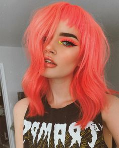 42 Unique Neon Peach Hair Color Trends in Glowing trends of neon peach hair color trends and ideas for every woman who are searching for best shades of modern hair colors. See here the stunning trends of neon peach hair colors to apply for long Peach Hair Colors, Hair Color Pink, Cool Hair Color, Pink Peach Hair, Pastel Coral Hair, Pink And Orange Hair, Coral Color, Dyed Hair Pink, Unique Hair Color