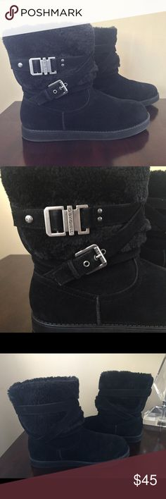 Guess size 8.5 Boots Guess size 8.5 women's boots! Worn ONCE! Like new condition, as seen in photos above. Black faux fur boots with buckle detail on sides. Very warm and cozy, these look great with leggings or jeans! Guess Shoes Winter & Rain Boots