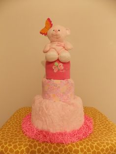 Beautiful butterfly themed 3-tier diaper cake is sure to be a pretty centerpiece for your next baby shower.
