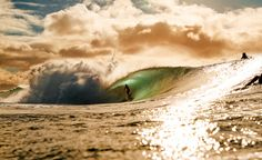 Beautiful! I don't know how photographers get such clean shots while they are on a surf board.