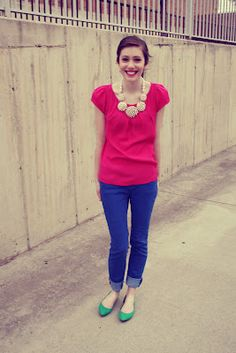 fuchsia top with blue jeans and green shoes