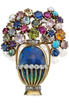 A multi gem-set giardinetto brooch, circa 1960 Designed as a vase set with an oval cabochon-cut opal and highlighted with single-cut diamonds, issuing a floral spray of vari-cut gems including sapphire, ruby, peridot, amethyst, aquamarine and turquoise, length 38mm