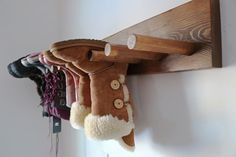 How to make a rack to hang your boots. This DIY is pretty easy -- and it's perfect for small entryways or rooms, and lets your winter boots hang dry!