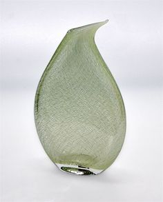 This fabulous vase was made by Michael Hunter for Twists Glass in 2016. Made of green merletto (lace) cane, it is a flat tear drop shape is scratch signed