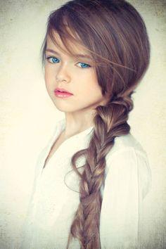 Brown hair & blue eyes :) this little girl is beautiful! Love her long hair!