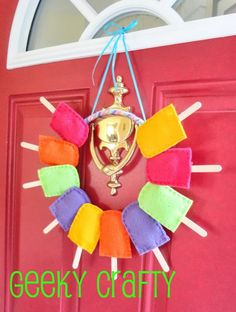 Summery Popsicle Wreath. Popsicles are the symbol of summer. It is so cool to take this idea to make such a summer wreath.