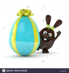 Download this stock image: 3d rendering of Easter chocolate bunny with present egg isolated over white background - HKC4JY from Alamy's library of millions of high resolution stock photos, illustrations and vectors.