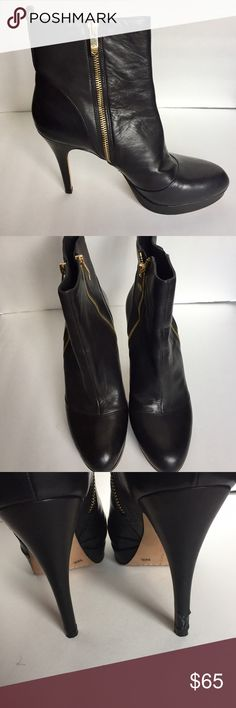 "VINCE CAMUTO EDORN Black Leather Boots - 9/39.5 These beautiful Vince Camuto Black Leather EDORN Booties are gently used with the only signs of wear on the back of the right heel - there is a small tear in the leather.  The leather on these boots are butter soft and there are no scuff marks on the leather upper.  The Gold zippers on each side add a chic sophistication.  Platform is 1"", and heel height is 4.5"" Vince Camuto Shoes Ankle Boots & Booties"
