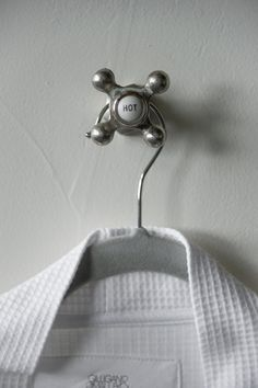 Plush bath robes hang beside the shower on vintage-inspired faucet hooks. Vintage Hooks, Earthy Color Palette, Wood Interior Design, Bathroom Pictures, Towel Hooks, Diy Network, Wet Rooms, Master Bathroom, Basement Bathroom