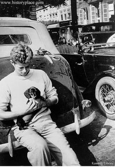 You like what I like. I know you do. So I know you wanna bone everything about this picture.  JFK, holdin' a puppy. Lookin' a little James Deanesque while leaning against a cool car, all nonchalant-like.  Bone city.