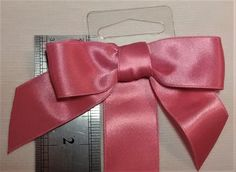 E-105 $1.25 Dark Peach Satin Bow