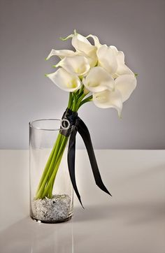 I will definitely have a long stem, white Calla Lilly bouquet.  I love the simplicity and elegance they exude.