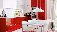 Modern red kitchen with RINGHULT HERRESTAD fronts, integrated appliances and white worktops