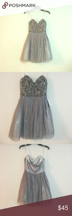 Gray Sequins strapless Prom dress. Gray Sequins strapless dress. Brand new with tags bought originally from dillards never been worn.  No trades! Dresses Strapless