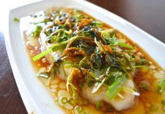 CANTONESE STEAMED FISH2 scallions fresh ginger, about 2 tablespoons julienned 1 small bunch of cilantro 1 ½ tablespoons soy sauce 1/8 teaspoon salt 1/8 teaspoon sugar 2 tablespoons water 1 medium tilapia, grey sole, flounder or fluke filet 2 tablespoons oil