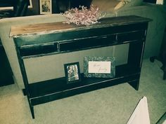 Black distressed accent table