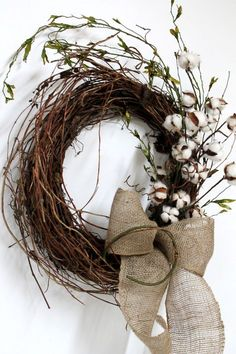 Primitive Front Door Wreath, Primitive Cotton on Twigs, Primitive Vine. Have some gold painted vines mixed into the wreath and a purple ribbon with lace over it.