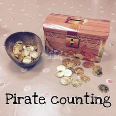 Metal pirate chest and gold coins for a counting invitation.